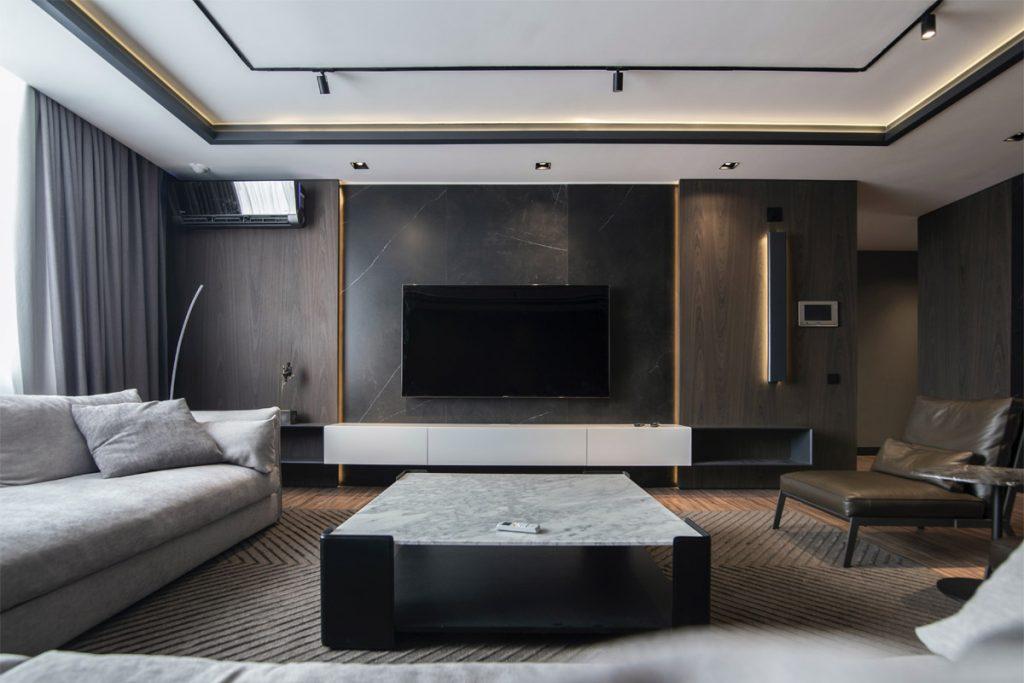 salon minimalista decorado con marmoles oscuros